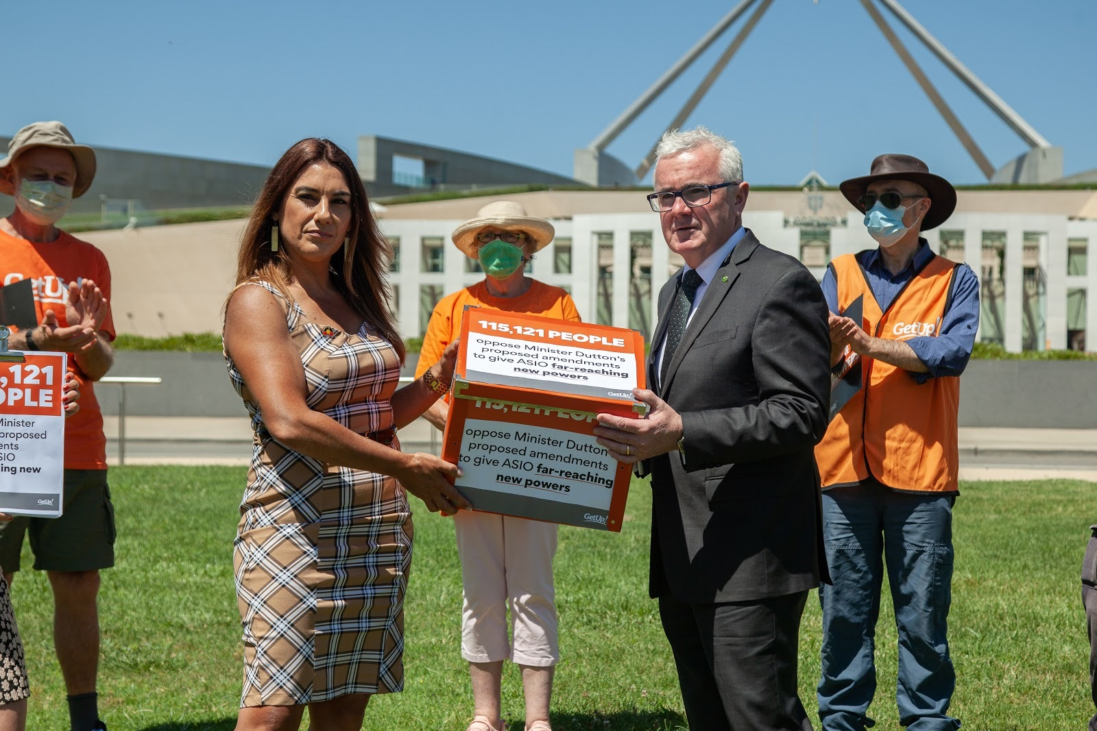 Greens Senator Lidia Thorpe and independent MP Andrew Wilkie accept GetUp''s petition on federal parliament lawns.