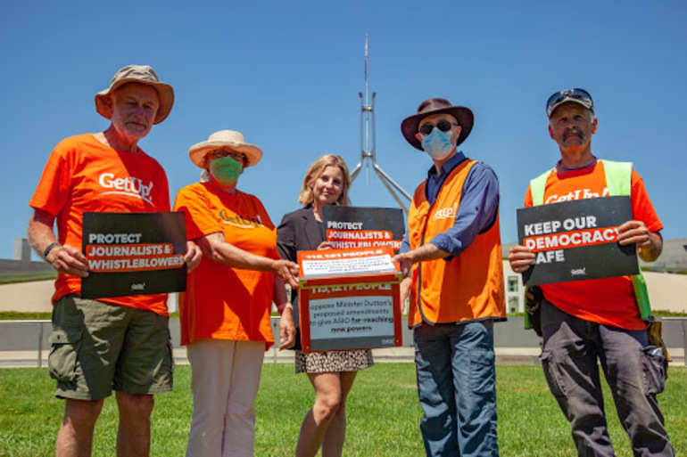 GetUp members with staff member Chandi on the federal parliament lawns delivering the ASIO petition.